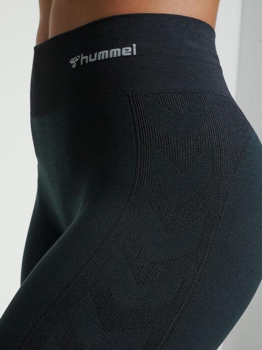hmlCLEA SEAMLESS MID WAIST TIGHTS, BLACK MELANGE, model